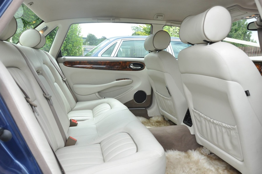 Our Jaguars are all matching Sapphire Blue with Light Leather interior.